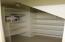 Under stairway storage.