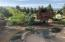 Professionally landscaped for beauty and privacy. 50'x50' fenced garden beyond trees.