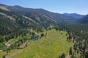 The large meadow is suitable for stock and has also been used as an airstrip. Large ponds and 3,000 feet of West Fork River frontage.
