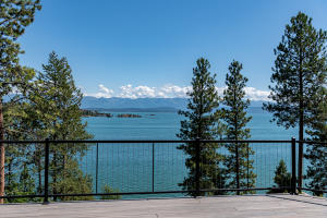 117.41 feet of Flathead Lake frontage, .58 acres, 3,440 sf home, 520 sf guest home, 4 beds/4.5 baths