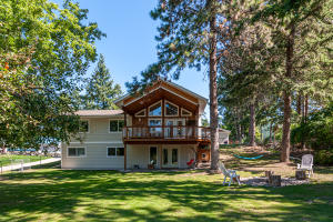 .42 acres, 2,664 sq. ft., 5 bedrooms, 3 baths, HOA Flathead Lake access, Fenced yard, Oversized 3-car detached garage