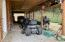 2 riding lawn mowers & 4 wheeler included with property