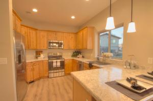 Agate Finish with Traditional Black Lighting and Stainless Appliances