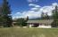 House with 3 car garage, carport for boat, 1 bedroom in law unit. Lake Lake Moran behind home.