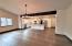 View from living area. Large space with circle-sawn Fir flooring throughout