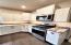 Custom cabinetry & marbled granite