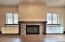 Custom cabinetry & rock fire place with North facing views