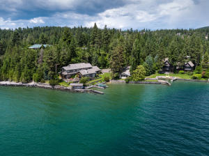 265+ feet of Flathead Lakefront, 1.2 acres, 5,322 sq. ft. main resident, 716 sq. ft. guest house, heated 676 sq, ft, attached garage, 1,314 sq. ft. shop/storage building