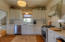 Stunning Kitchen with high-end stainless steel appliances including gas cooktop
