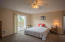 Unit A Master Bedroom with Sliding Glass Doors to Balcony