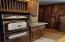 Custom Black Walnut Cabinets, Rough Edge Granite Counter tops