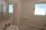 Upper Level Guest Bath in- shower leaded window~privacy and light!
