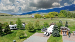 Aerial view of the RV lot, backing up to an historic Ranch and unobstructed view of the Canadian Rockies.