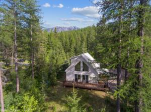 A very special property tucked away on a forested ridge facing Glacier Park.