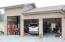 Open 3-car attached garage.