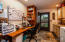Laundry/office/storage and access to backyard, main level