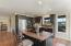 Open kitchen with Mexican Saltillo floor tiles.