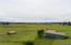 Horse barn/storage on 5 fenced acres. Adjacent parcel is 1000 acres.