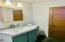 Upstairs bath has door from hallway as well as a door from Bedroom #2