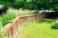 Private fenced yard and bamboo fence.