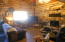 Cozy western living room w/stone heatilator fireplace.