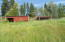 Lower pasture w/barn & loafing shed.