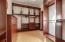 Walkin closet with all custom closet system. Bamboo Floors.