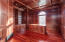 Office with Mahogany walls and cabinets. Brazilian cherry wood floors.