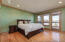 Upper level bedroom with private ensuite bath and walkout balcony.