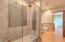 Lower level bath ensuite with additional access to the laundry.