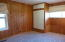 Knotty pine walls and built in closet