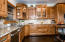 Wolf and Sub Zero Appliances, custom range hood and cabinets, granite and more!