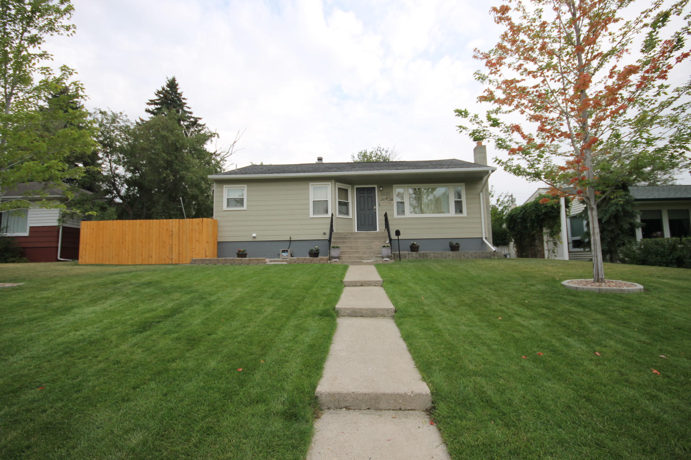 Immaculate east end home with many updates! Spacious living room, updated kitchen and main floor bathroom.  Newer hot water heater and fence. Enjoy summer nights on the wood deck.