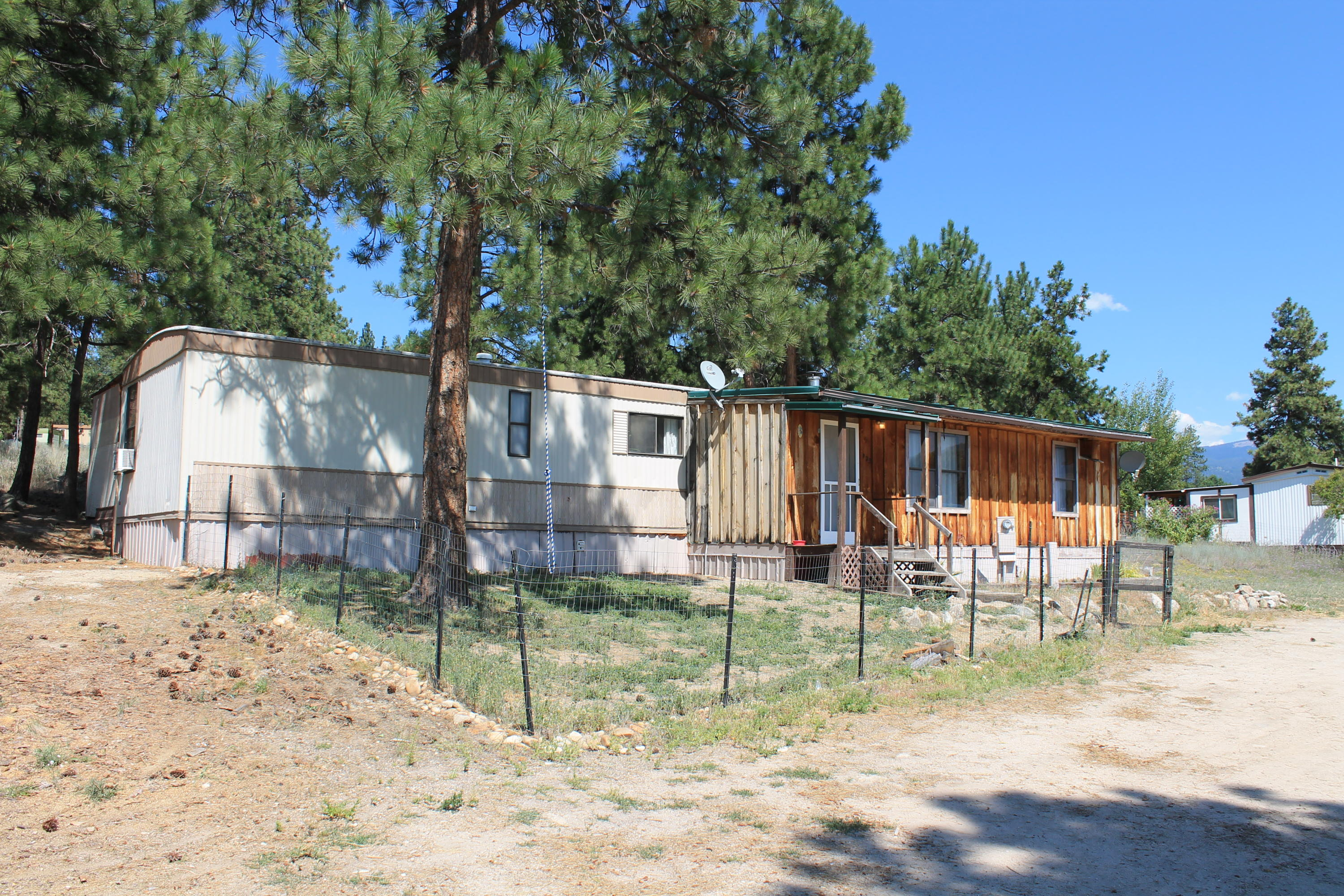 Enjoy all the Bitterroot has to offer from this conveniently located home just minutes from access to National Forest, the Bitterroot River, and downtown Hamilton. When you're done playing in the woods warm up by the cozy wood fire place or kick back in the front yard and watch the sunset over Como Peaks. This Single wide trailer with multiple additions displays pride of ownership throughout. All at an affordable price point!  Lot rent is $315 per month and includes water, septic, garbage service, and snow removal. Shed on property stays.Two of the bedrooms are non-conforming.Please call Haley Schultz at 406-546-6448, or your real estate professional.