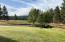 West border of property, Landscaped with view of Golf Course across Golf View Dr.
