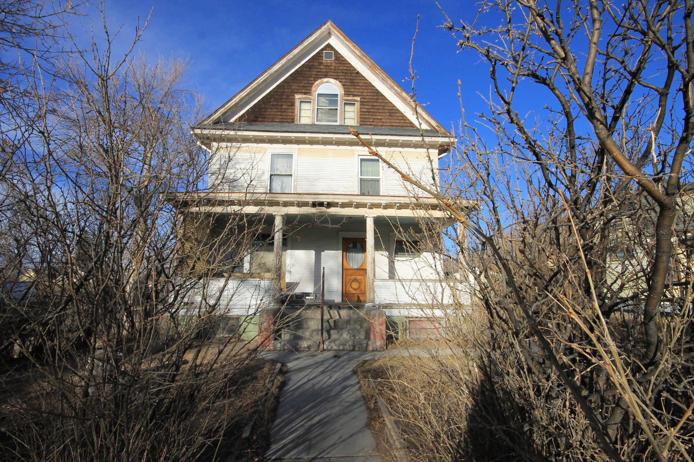 At one great time this home was a triplex and maybe even a four plex.  Currently it is zoned R-9 with a multi family status as conditional with buyer's application to the City of Great Falls with approval.  Being sold as is.