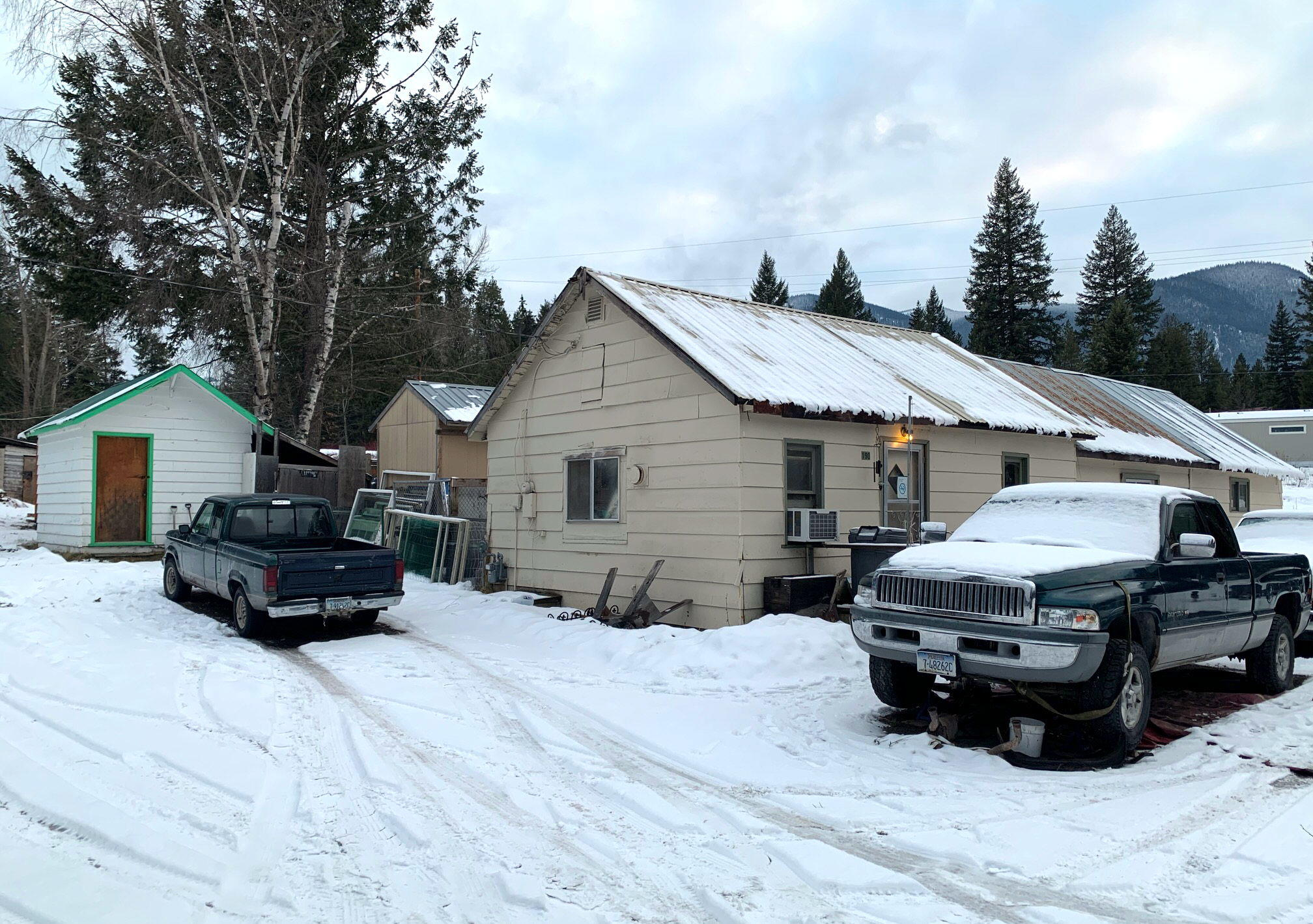 An eight minute drive from the west entrance to Glacier Park.  Just one minute the other direction is the south fork road, leading to vast miles the Great Bear and Bob Marshall Wilderness areas.  Convenient to the amenities of town and less than 15 minutes to Columbia Falls.  You will be hard pressed to find a more affordable option than this fixer upper in our market now.  Even with a complete remodel, it will still be relatively affordable in this market.  Sold As-Is.  Seller will need minimum 30 days rent-back after closing.  Seller indicates this loan appears to be assumable.  Very likely will not finance for most loans as it sits now.  Call Justin Burt 406-885-7453 or your real estate professional!