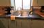 Modern stainless steel and butcher block counter tops.