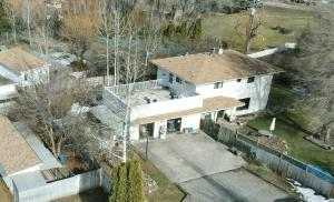 Ariel view of home with garages converted to easy-access offices for a home-based business.
