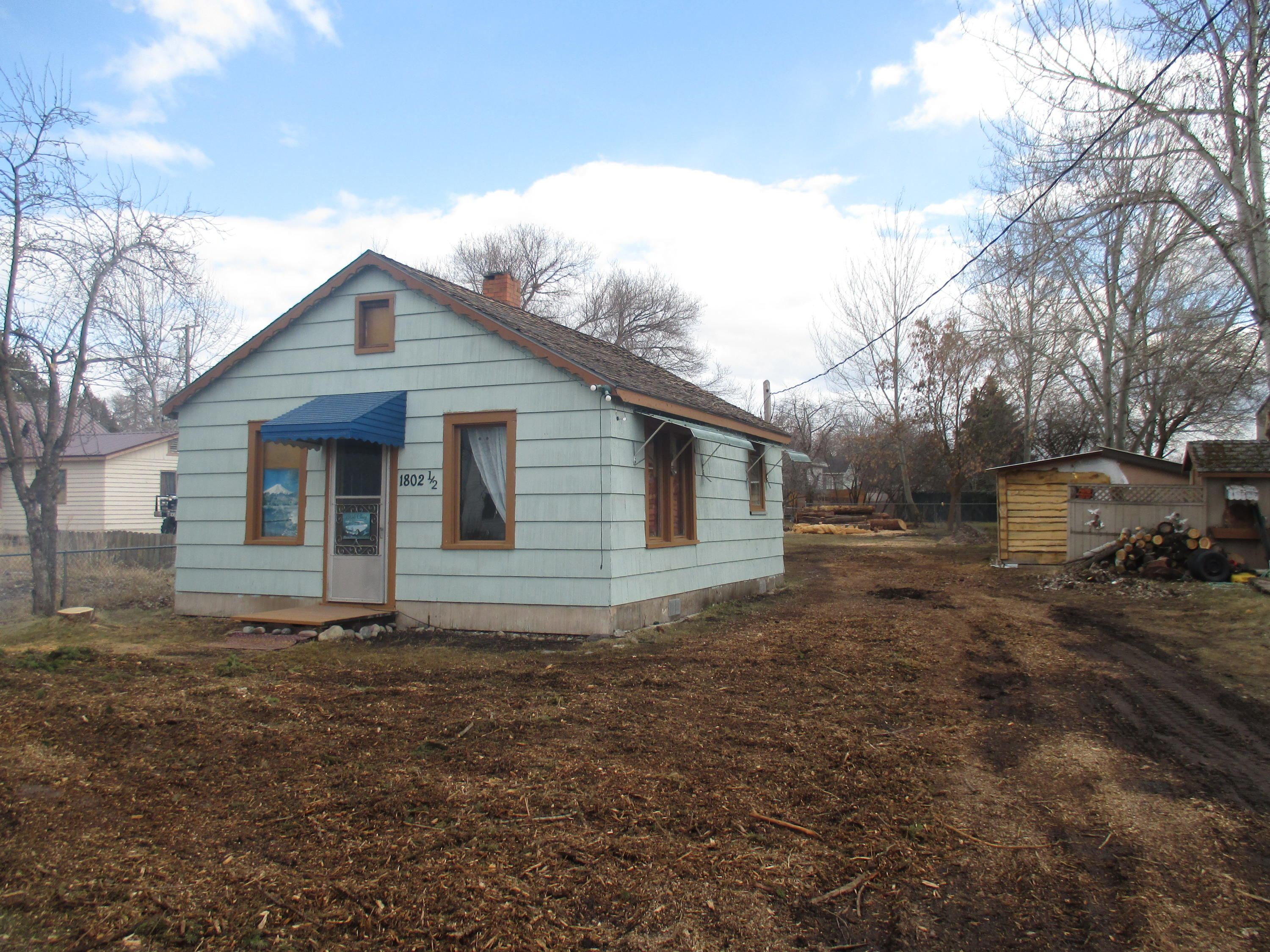 Investors? Builders?  Little home on pier foundation w/several outbuildings including small workshop.  Fenced .2 acre lot.  Zoned RA-1 for many uses. Water & Sewer to property (not piped into house). Bathroom is outhouse. Water spicket also outside.  Seller has means to demolish home for Buyer (negotiable). Call Janeen at 250-1333 or Your Real Estate Professional.