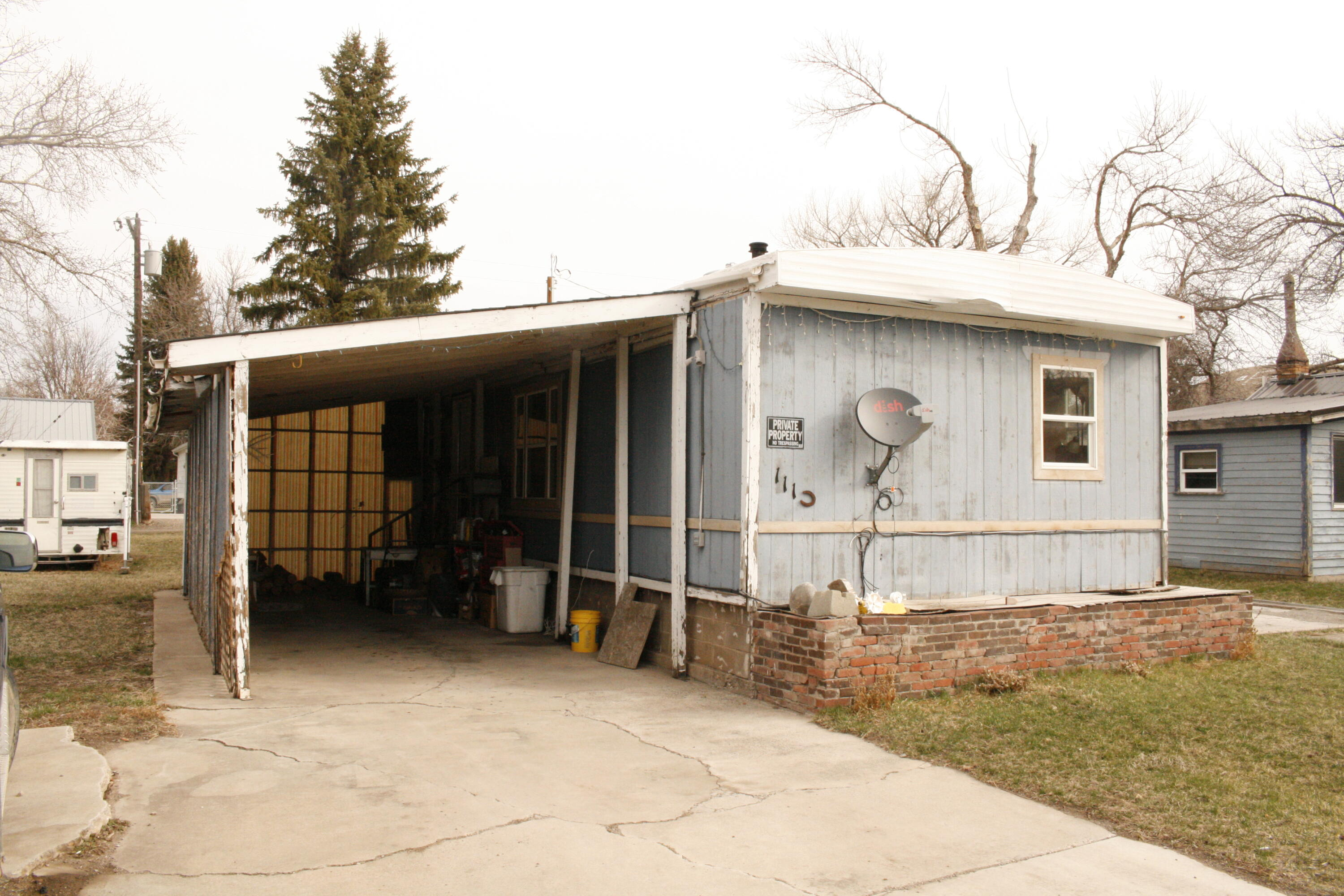 This property consists of just under half an acre with a small studio house and a 3 bedroom 1973 mobil home. Both buildings are in need of much TLC.