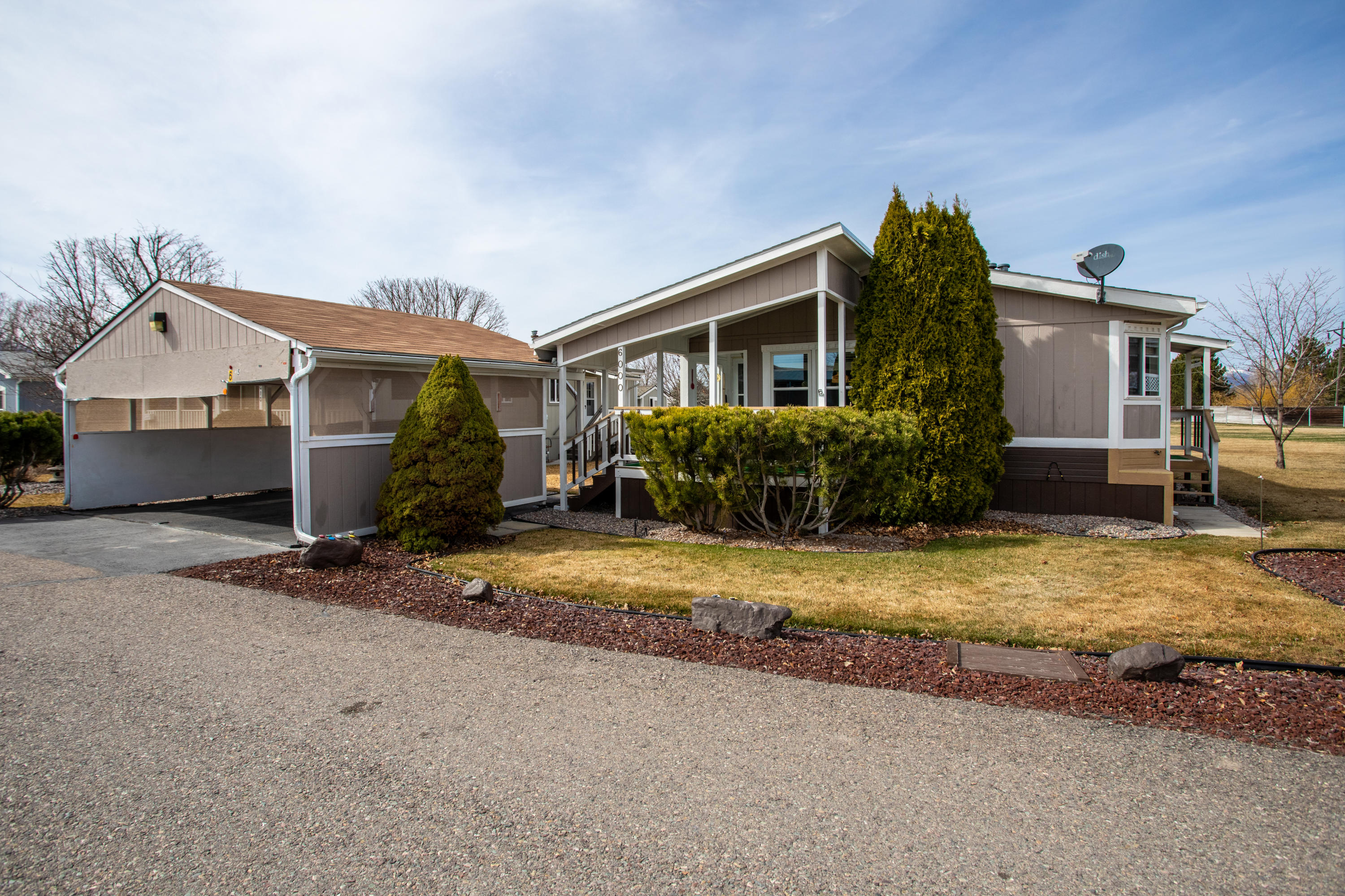 Move in ready and well cared for manufactured home in the Katoonah Lodges, a community for people 55 and older with walkways and parks. This home comes with covered parking and newly placed exterior carpeting on the deck. Walk in to a bright living space and an open concept floor plan. The kitchen has plenty of counter space and storage with a pantry closet. The master bedroom is large with views over common area and an ensuite including a soaking tub. The laundry room is large with a door to the side yard. Outside there are mature trees and a well maintained yard with underground sprinklers. A storage shed is located in the back of the lot. Listed by Danni Moore.