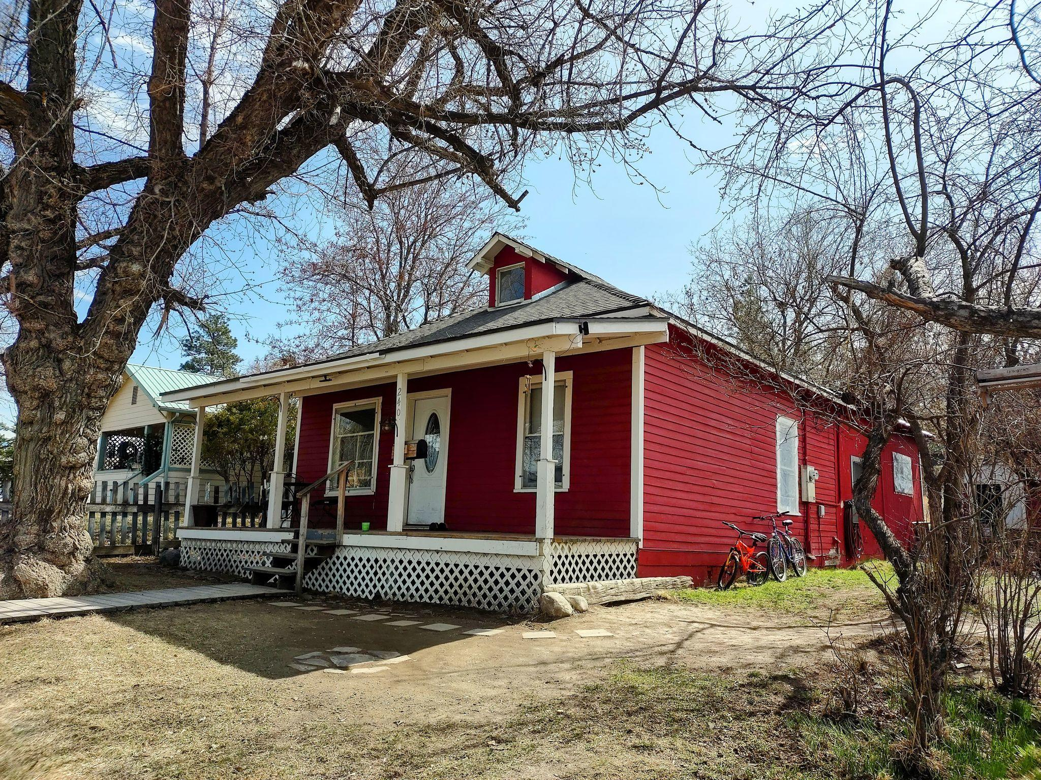 **Highest/best by Thursday at 5 pm. Response by Saturday , 5 pm.**AFFORDABLE and ADORABLE!  From the charming farmhouse sink and cabinets in the kitchen, to the warmth of the pellet stove in the living room, the main floor laundry room, the soft color choices, the 3 bedrooms and large full bathroom, the versatile loft space, and the cozy front porch with mountain views; you will feel right at home.  The two sheds in the back yard offer lots of storage with room to build a garage or for off-street parking.  The lot next door is also for sale and purchasing both would be a great option for a larger yard with extra set of full utilities(city water/sewer, electric meter) for RV guests or as an investment to put a mobile home on for extra income. See MLS # 22104819.