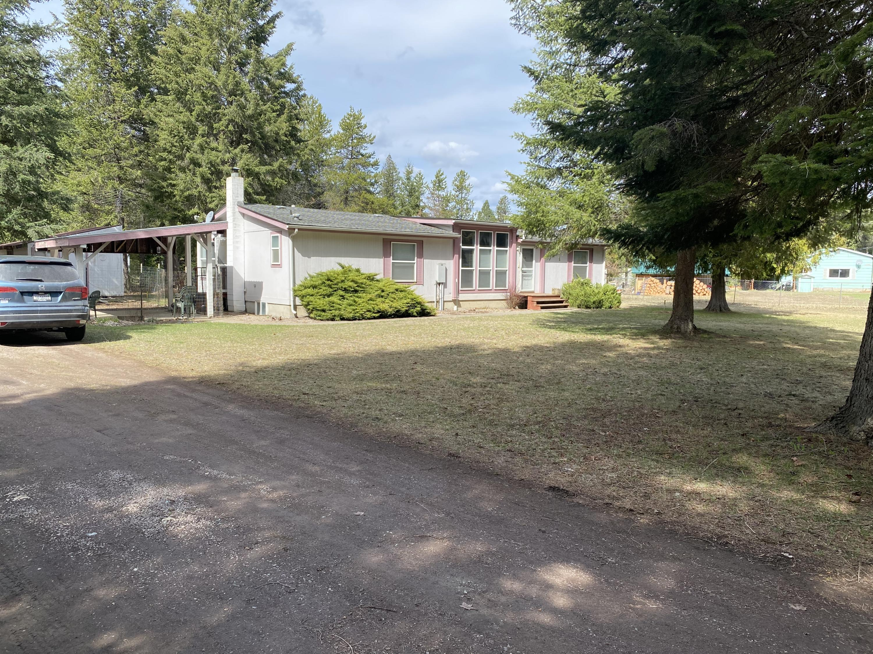 1997 Manufactured  home on a basement foundation.  This home has 3 bedrooms, 2 full baths and open floor plan.  The basement is a blank slate.  Home is de-titled and considered real property.  Nice level yard, 3 car garage and only 3 miles out of town.  BEING SOLD AS IS WITH NO WARRANTIES OR GUARANTEES.