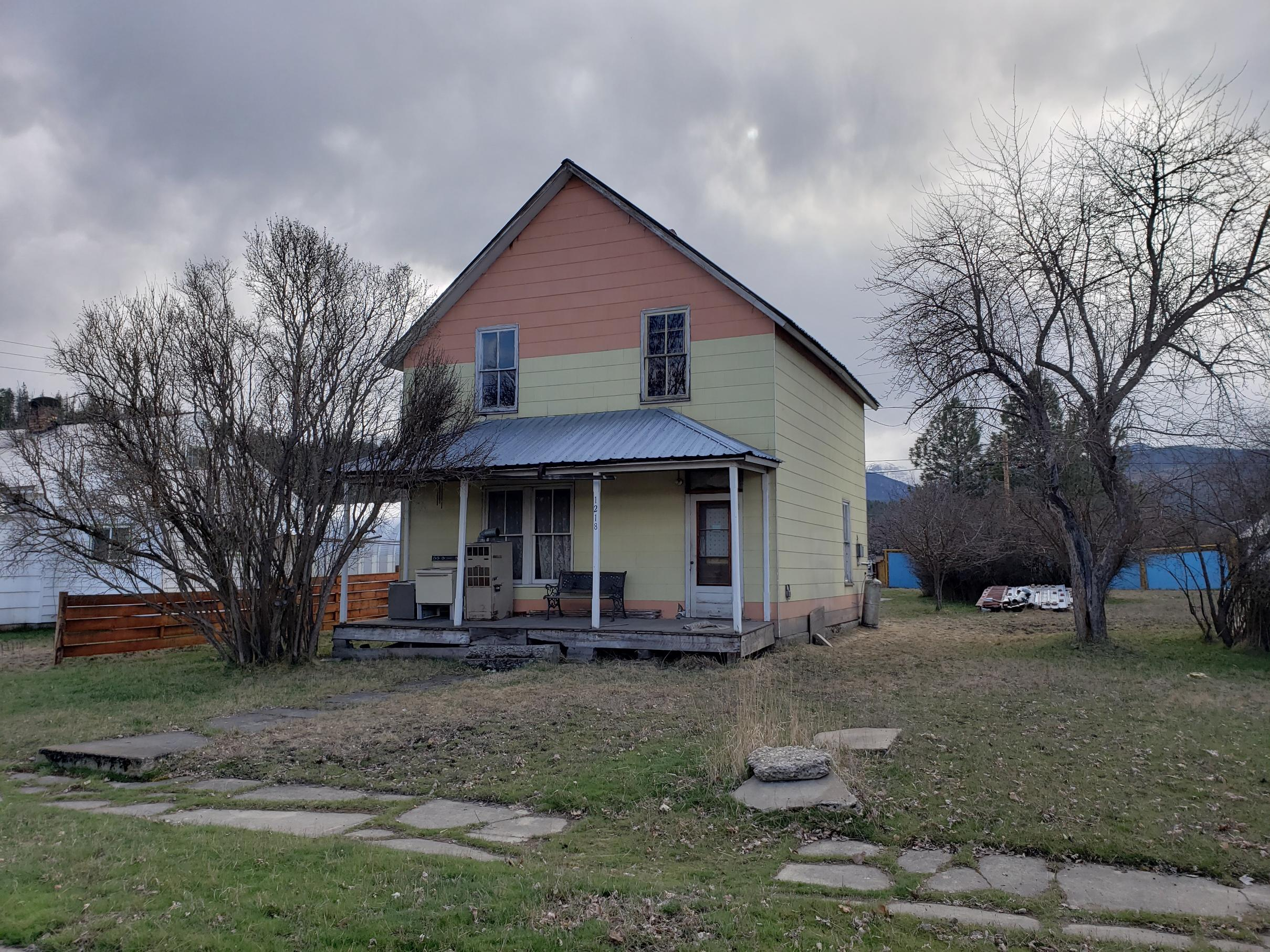 Opportunities abound with this fixer upper located on 2 city lots.  New sewer and water lines have been brought to this home along with a new panel box for electricity.  Put your carpenter skills to work as you breath new life into this 1910 farmhouse.  This home comes with 2 city lots, so you  can enjoy a remodel and also split the lots and build a new home  as well.   Whether you remodel or decide to build brand new, this property definitely provides possibilites.  Call for an appointment to see this great opportunity today!