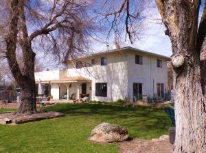Beautiful two-story stucco home with rooftop deck.