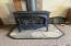 Just installed this gas stove which heats house well, with back-up wall heaters in bedrooms and bathroom.
