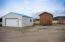 Additional outbuildings! A large garage/shop and shed