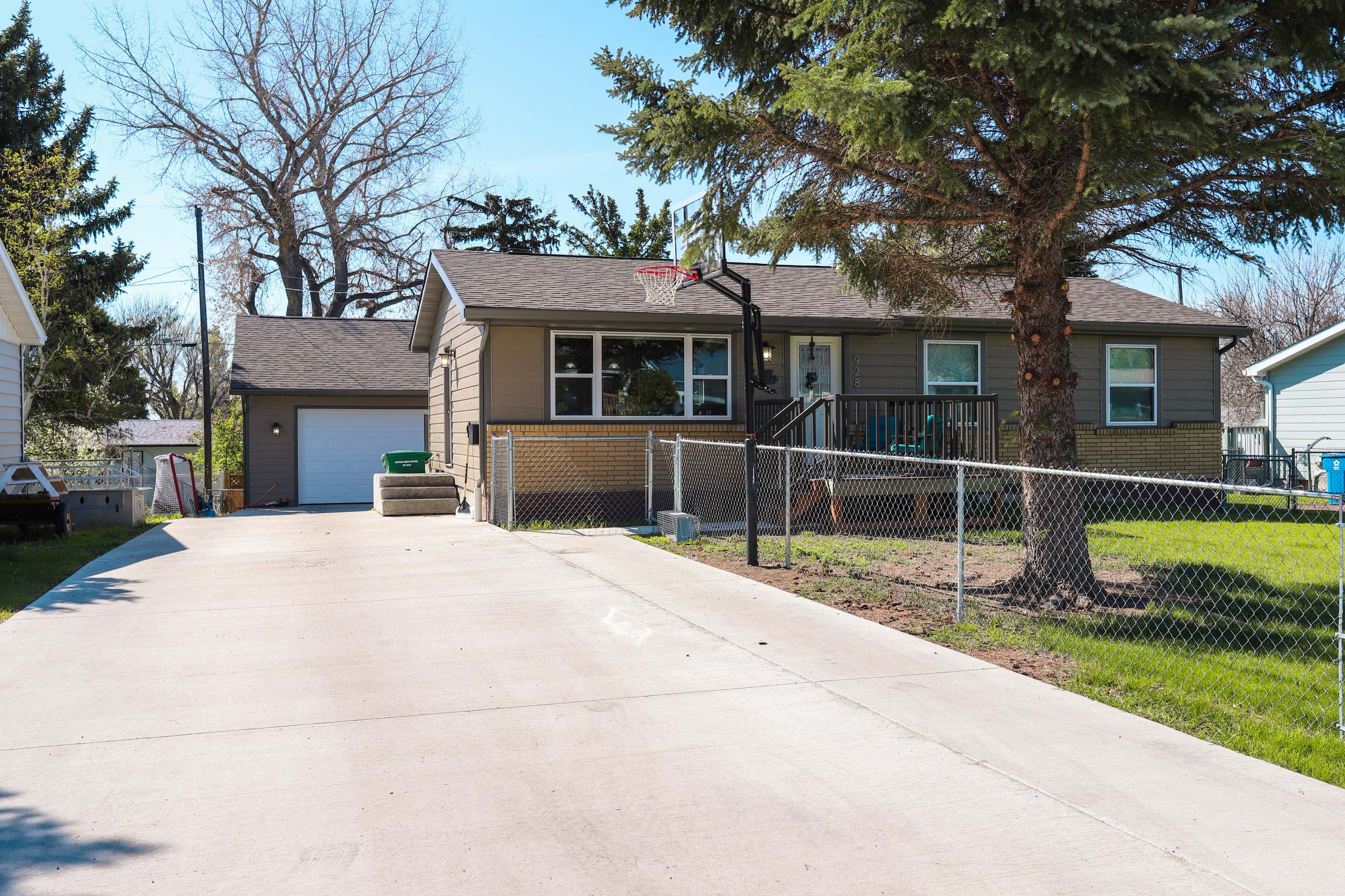 Looking for the perfect place to call home? You'll be able to move in and enjoy this 4 bedroom, 2 bath home. Walk out to a fully fenced backyard and a heated double garage with bonus parking. Don't miss your chance! Call Kyle Tschetter at 406-282-3500, or your real estate professional.