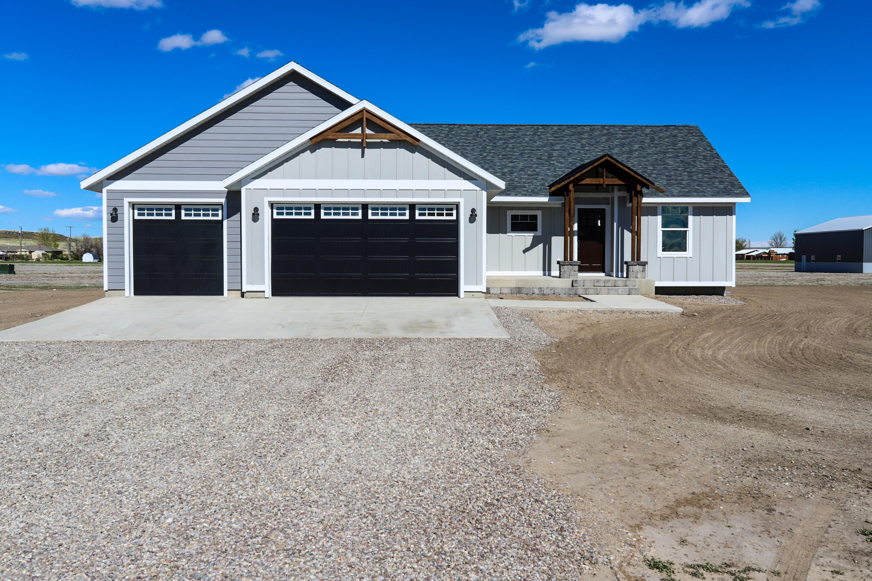 SWEET HOME MONTANA in this BRAND NEW BUILD nestled in the quaint town of ULM just a short drive from Great Falls! Situated on 2 acres, this gorgeous new home features a 3 car attached garage,  true master suite, MAIN FLOOR LAUNDRY, 3 bedrooms & 2 bathrooms on the main level, 2 bedrooms & 1 bathroom below grade with a large living room and 9 ft ceilings! The kitchen is ordained by high end finishes, granite counter tops, and the open floor plan is accentuated by a gas fireplace.   It also features a sprinkler system, pressure dosed septic system, two 1500 gal cisterns, and 2 community wells for irrigation! it is all about the details.  Listed by Melissa Dascoulias.